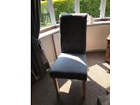 Four grey dining chairs