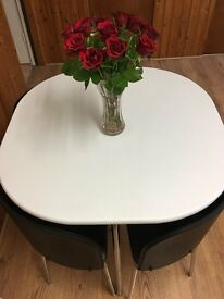 ***WHITE HYGENA SPACE SAVER DINING TABLE AND FOUR BLACK LEATHER CHAIRS***