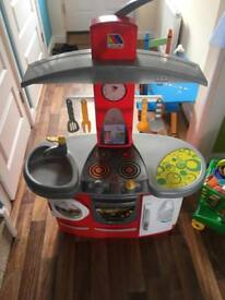 Children's play kitchen and trolley