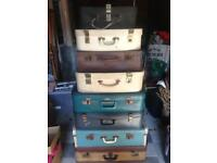 8 vintage suitcases for sale