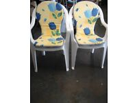2 White Plastic Garden Chairs with Cushions.