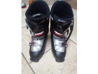 Mens Salamon ski boots. ALS0 various skis and poles . Will split. £10 per pair.