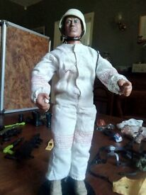Action Man with assorted clothing, weapons and accessories
