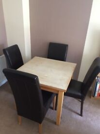 Extentable dining table and 4 faux leather chairs