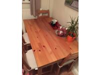 Solid pine dining table, chairs not included