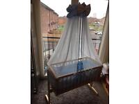 Swing crib wooden with blue canopy