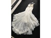 Wedding dress. Pronovias. Ivory. Size 14. Fishtail. Crystal Encrusted. Backless. Large train