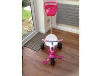 Pink SmarTrike tricycle