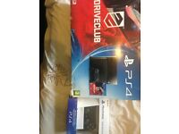 Playstation4 in box with a controller and 3 games