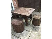 Wood table and four tree stump seats