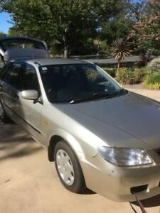 Mazda 323 2002 Model - Must sell negotiable