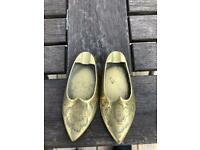 2 brass shoes