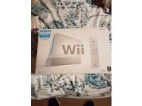 TWO NINTENDO WII CONSOLES.