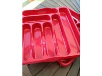 Two red cutlery trays