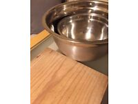 Small + large mixing bowl and wooden chopping board