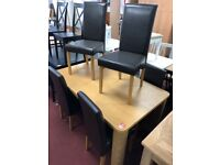 chunky table and 6 black chairs