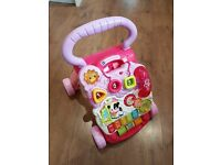 Vtech baby walker in pink. Complete with phone.