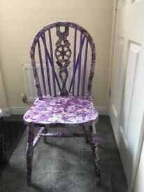 Wooden chair decorated with decopage
