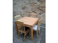 Ikea light pine extending table & 4 chairs, 2 Black/2 White
