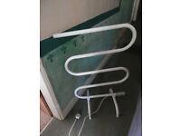 White, Tubular, Electric Heater. Towel rail.