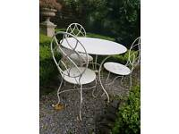 Painted wrought iron garden table and chairs