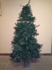 Six foot artificial Christmas tree.