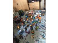 Bundle of skylander and Disney infinity figures discs and portals