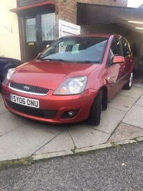 Red Ford Fiesta Ghia 1.4, 102,300 miles.