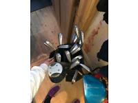 Selection of used golf clubs, balls and golf tees all different types and sizes