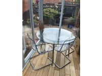 IKEA Salmi/Tobias round dining table and 4 Perspex chairs