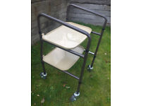 Mobility trolley with two trays for indoor use.