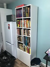 White bookcase with bottom cupboards