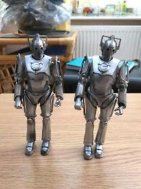 Two Doctor who Cybermen figurines