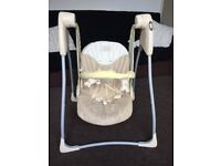 Graco swing, safety harness, washable seat cover and folds.