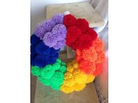 Wreaths of any kind made of pom-poms. Christmas, Valentine's, traditional or funky