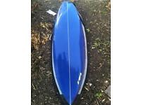 "Tiki Fish surfboard 6'10"" with fins, leash and bag"