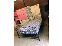 Very nice rod iron double bed with mattress