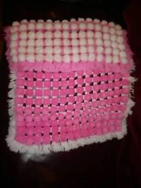 Handmade baby pom pom blanket
