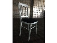 150x Chivari Stacking Chairs - Silver with Black Cushions - NEED ATTENTION