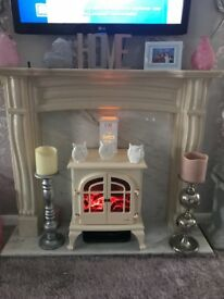 Fire surround marble hearth and electric stove fire