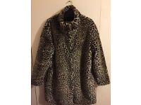 Zara leopard faux fur in Size M.