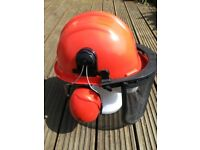 Safety helmet, Chainsaw etc with mesh visor and ear defenders. Adjustable headband