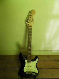 Squier Stratocaster electric guitar with case