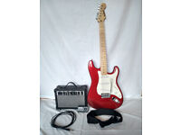 Stratocaster style complete electric guitar set in very good condition for sale