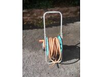 Garden hose on reel with wheels