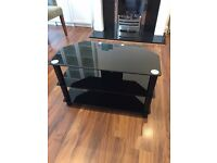 Excellent condition black glass three tier TV stand with cable management holes on the back