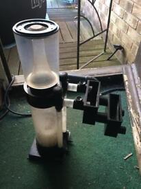 Fish tank skimmer and pump.