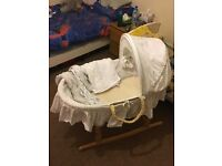 Moses Basket, stand and sheets.