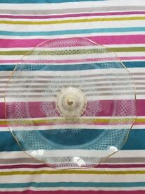 Beautiful single tier glass cake stand. No chips or cracks.