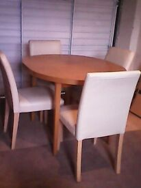 Dining table with cream cushioned chairs